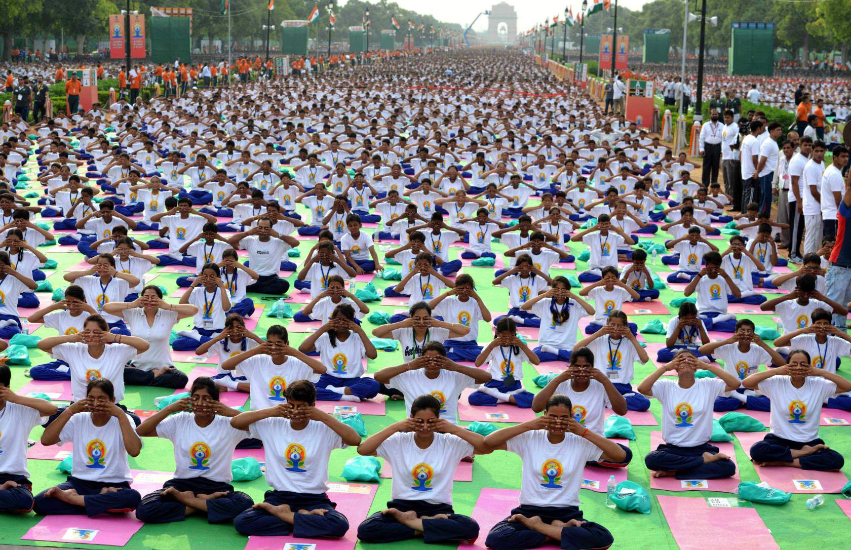 NEW, DELHI - INDIA: Indian Prime Minister Narendra Modi (not seen) performs yoga along with others at Rajpath during mass yoga session to mark the International Day of Yoga on June 21, 2015 in New Delhi, India. An estimated 40,000 people participated in the celebrations at Rajpath, with around two billion people taking part across the world. The yoga celebrations are being organised after the United Nations had in December last year declared June 21 as International Yoga Day. (Photo by Vinod Singh/Anadolu Agency/Getty Images)